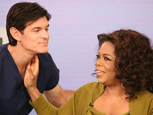 Oprah checks Dr. Oz's resting heart rate. (Oprah.com)