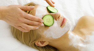 woman at spa with cucumbers on eyes