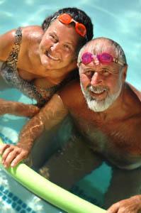 elderly couple swimming