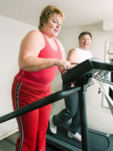 overweight couple on treadmill