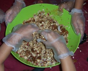 kids making granola