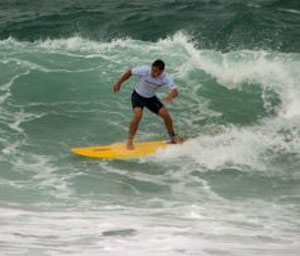 man on yellow surfboard