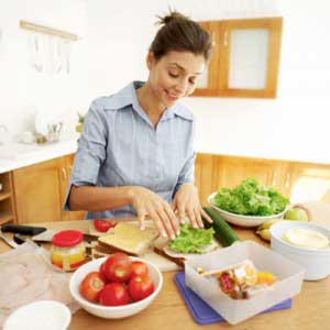 woman making healthy lunch
