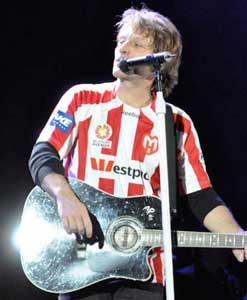 Bon Jovi wearing sports jersey