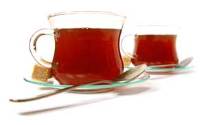 Two cups of tea in clear cups