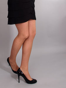 Women's long legs, with high heels and black skirt