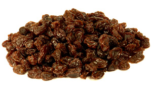 raisins in a pile on a white background