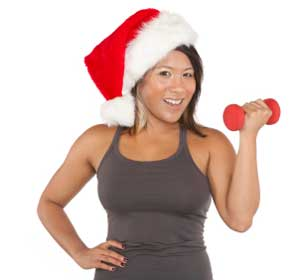 girl exercising while wearing a santa hat
