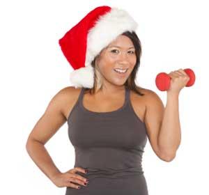 girl exercising while wearing a santa hat