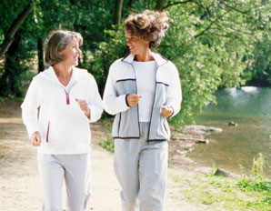 Two women walking ourdoors for fitness