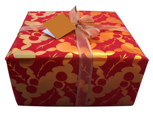 holiday box wrapped in gold and red paper