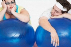 two overweight people with exercise balls