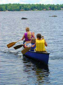 campers rowing a boat
