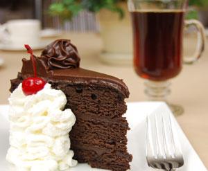 cake with whipped cream and tea