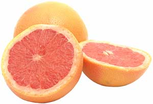 whole and sliced grapefruits
