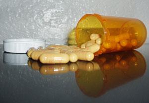 pills spilling out of a perscription bottle