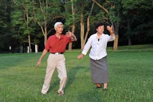 elderly couple doing tai chi