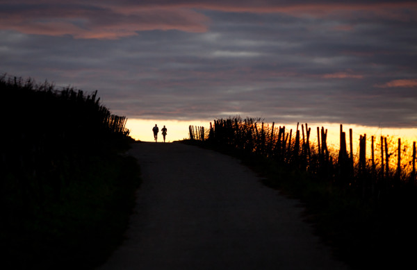 Couple running sunset