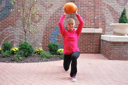 Lunge with Pumpkin Overhead
