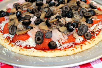 Black Olive Topping on entire Pizza - 15